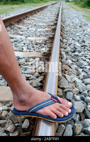 Foot on railway track.  Kep. Cambodia.