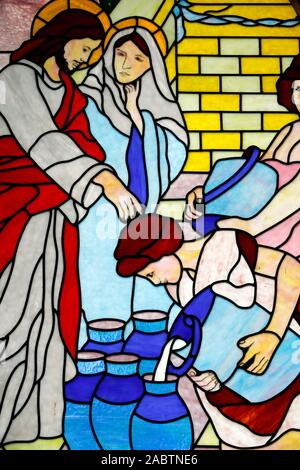 Holy Rosary church. Stained glass window. Marriage at Cana.  Sapa. Vietnam. - Stock Photo