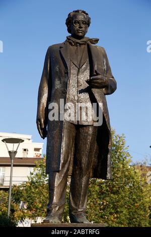 Statue of Ibrahim Rugova in Pristina, Kosovo. - Stock Photo