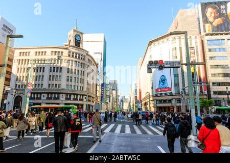 The Ginza 4 crossroads with the Mitsukoshi store and Wako building. People walking along the street when it is a pedestrian precinct at weekends. - Stock Photo