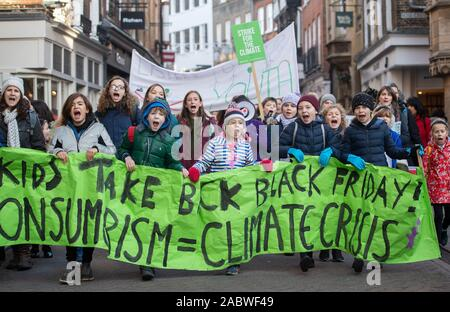 Children take part in the YouthStrike4Climate march in Cambridge. - Stock Photo