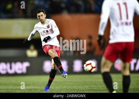 Uzbek football player Odil Ahmedov of Shanghai SIPG F.C. passes the ball during the 29th round match of Chinese Football Association Super League (CSL) against Beijing Renhe in Beijing, China, 27 November 2019. Beijing Renhe tied the game with Shanghai SIPG with 3-3. - Stock Photo
