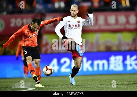 Austrian football player Marko Arnautovic of Shanghai SIPG F.C., right, attempts to steal the ball during the 29th round match of Chinese Football Association Super League (CSL) against Beijing Renhe in Beijing, China, 27 November 2019. Beijing Renhe tied the game with Shanghai SIPG with 3-3. - Stock Photo