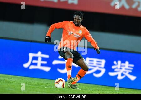 Senegalese football player Makhete Diop of Beijing Renhe F.C. keeps the ball during the 29th round match of Chinese Football Association Super League (CSL) against Shanghai SIPG in Beijing, China, 27 November 2019. Beijing Renhe tied the game with Shanghai SIPG with 3-3. - Stock Photo