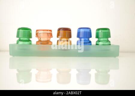 Dental medicine bottles,colorful glass bottles.Pharmaceutical small bottles.Small chemical glass bottles on white background Stock Photo