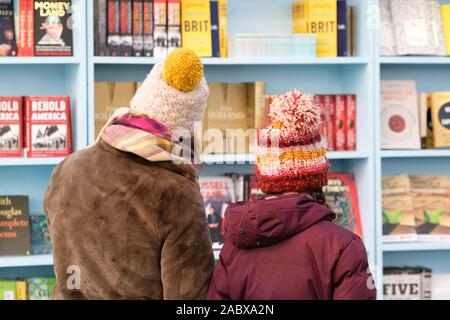 Hay Festival Winter Weekend, Hay on Wye, Powys, Wales, UK - Friday 29th November 2019 - Visitors browse the selection of new books at the Hay Festival Winter Weekend. Credit: Steven May/Alamy Live News - Stock Photo