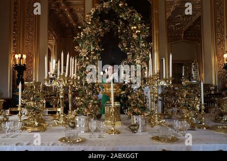 Celebrate Christmas at the official residences of Her Majesty The Queen .This December , visitors to Windsor Castle  will see the State Apartments transformed with shimmering Christmas trees , twinkling lights and a range of activities to celebrate the festive season . - Stock Photo