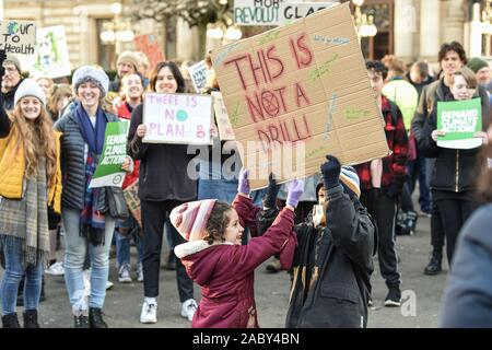 Glasgow, UK. 29th Nov, 2019. Glasgow, United Kingdom. Friday, November, 29th, 2019. Supporters of the YouthStrike4Climate protest in George Square, Glasgow. Credit: Kenny Brown/Alamy Live News - Stock Photo