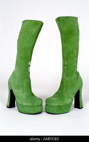 Green, high heel platform ladies swede boots. - Stock Photo