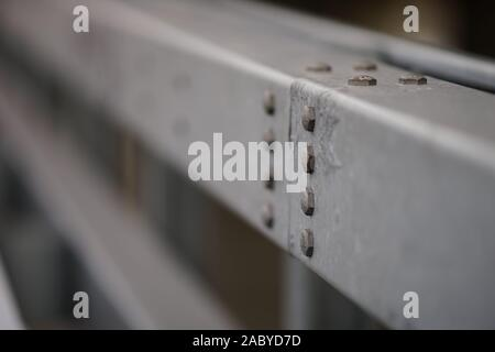 bolt caps on steel structure close-up - Stock Photo