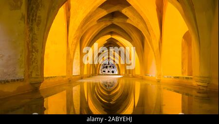 The baths at the Real Alcazar de Sevilla, The Royal Alcázar of Seville is a royal palace in Seville Andalusia Spain - Stock Photo