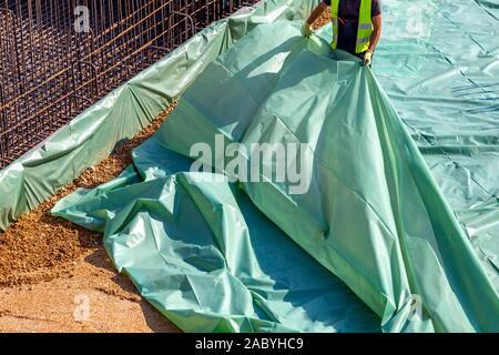 Vapour barrier before pouring concrete slab, helping to prevent moisture from migrating up from the dirt and creating a wet slab. - Stock Photo