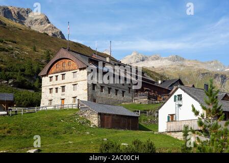 The historic heritage Berliner Hütte alpine lodge in the Ziller Valley in the evening light, Tyrol, Austria - Stock Photo