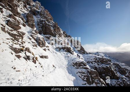 Mountaineers on the Munro An Teallach, one of Scotlands finest mountain traverses, above Dundonell, Scotland, UK. - Stock Photo