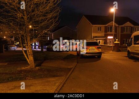Cork, Ireland. 29th Nov 2019. Shooting in Chapelgate, Ballyvolane, Cork City. At around 7:45 today multiple units of An Gardai Siochana including unmarked garda cars, armed response, and marked cars attended a shooting in Chapelgate Ballyvolane, Witnesses said there was up to 6 shots fired in the estate just before the gardai rushed to the scene. Credit: Damian Coleman/Alamy Live News - Stock Photo