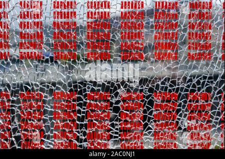 Close up of broken safety glass wirth red stripes - Stock Photo