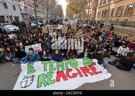 Turin, Italy. 29th November 2019. People demonstrate in a sit in with banner during the Global Climate Strike declared by Fridays for Future. Credit: MLBARIONA/Alamy Live News - Stock Photo