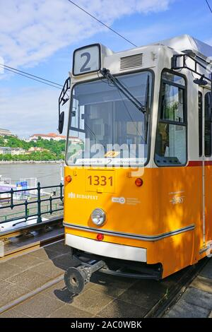 BUDAPEST, HUNGARY -27 MAY 2019- View of a yellow tram on the street in downtown Budapest, Hungary. - Stock Photo