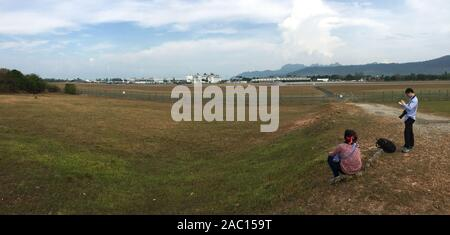 Langkawi, Malaysia - Mar 29, 2019. Taking pictures of airplanes near the Langkawi Airport. Langkawi is an archipelago made up of 99 islands on Malaysi - Stock Photo