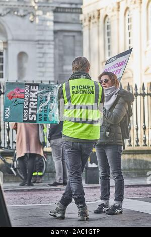 Striking lecturers at Cambridge university, England, stand outside Senate House on Friday 29th November 2019 to protest about changes to their pensions. - Stock Photo