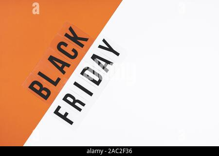 The inscription in black letters BLACK FRIDAY on a gray orange background - Stock Photo