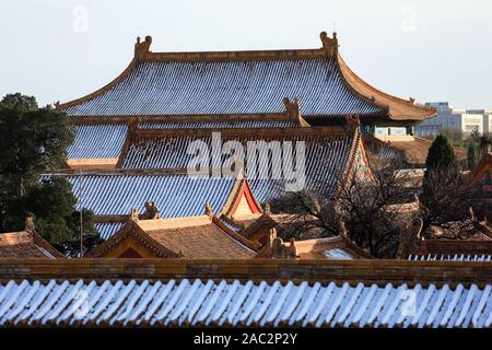 The roofs of the halls are covered with snow at the Forbidden City, also known as the Palace Museum, in Beijing, China on November 30th, 2019.   Beiji - Stock Photo