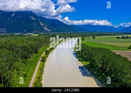 Floodplain of the Rhone river, looking upriver into the Lower Valais, Le Bouveret, Port-Valais, Valais, Switzerland - Stock Photo