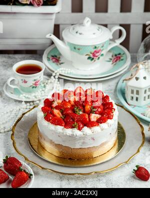 strawberry cheesecake with lots of strawberries on top - Stock Photo