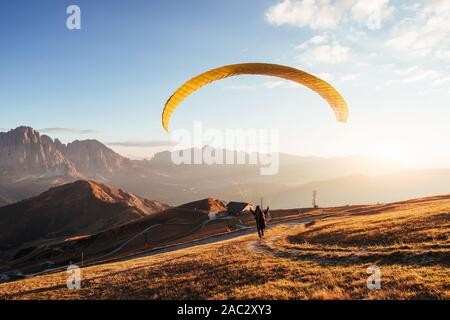 On the way in taking off the mountain of Seceda dolomites - Stock Photo