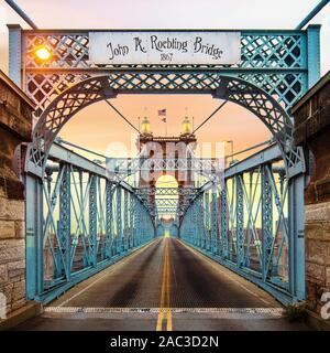 John Roebling Bridge located in Cincinnati, Ohio. This bridge spans the Ohio River. Also know as the suspension bridge. - Stock Photo