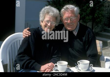 happy mature couple out having tea - Stock Photo