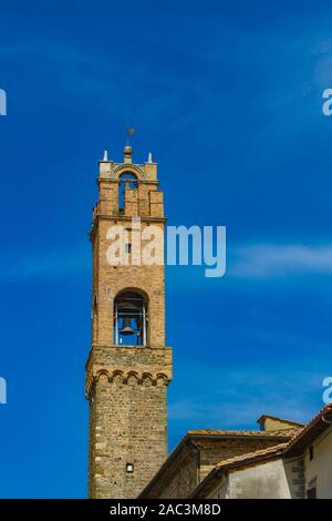 View at clock tower of Palazzo Dei Priori in Montalcino, Italy - Stock Photo