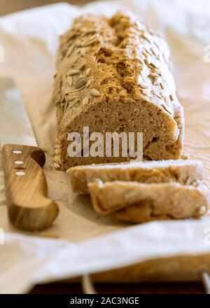 Homemade multigrain loaf of bread - Stock Photo
