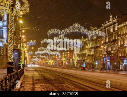 Nevsky prospect, St. Petersburg. Russia 11 December 2018.  Snow-covered and decorated for the New year Nevsky prospect in the early December morning. - Stock Photo