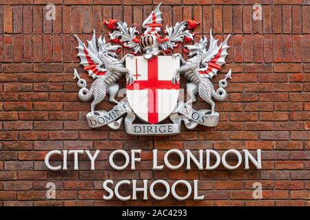 LONDON, UK - AUGUST 10, 2017: The coat of arms of the City of London School on a brick facade in London. - Stock Photo