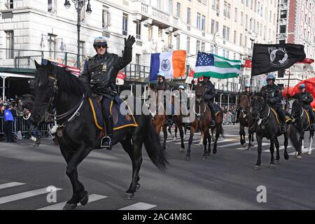 NEW YORK, NY - NOVEMBER 28: NYPD Mounted Unit participate at the 93rd Annual Macy's Thanksgiving Day Parade on November 28, 2019 in New York City. - Stock Photo