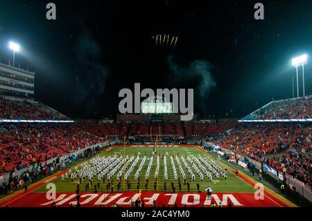 Raleigh, North Carolina, USA. 30th Nov, 2019. Nov. 30, 2019 - Raleigh, North Carolina, USA - The NC State band, 'The Most Dangerous Band in the South, ' plays the National Anthem as a aerial demonstration team flies over Carter-Finley Stadium before Saturday's game between the NC State Wolfpack and University of North Carolina Tar Heels. The Tar Heels defeated the Wolfpack, 41-10. Credit: Timothy L. Hale/ZUMA Wire/Alamy Live News - Stock Photo