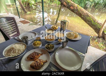 South Indian Food Being Served on Table in Alleppey Kerala India - Stock Photo