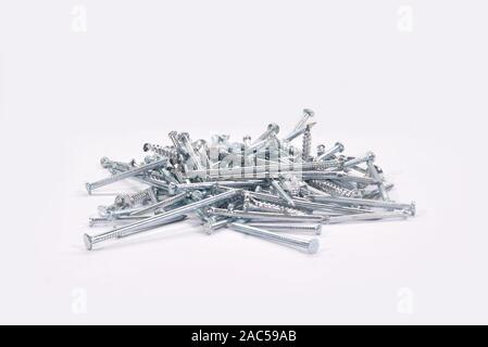 Construction materials.Gray iron nails on white background. - Stock Photo