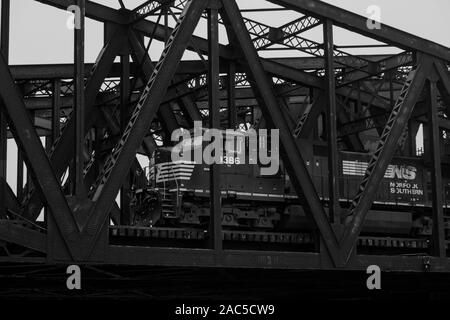 chicago illinois ash street drawbridges over shipping canal steel girders bridge pattern black and white norfolk southern freight locomotive - Stock Photo