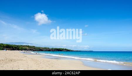 Hapuna Beach, along the Big Island of Hawai'i's Kohala Coast with Hualalai mountain in background. This white sand beach has been rated one of the bes