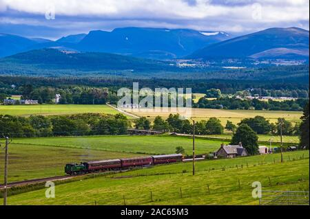 Strathspey Railway heritage train pulled by tank steam engine Braeriach arrives at Broomhill Station south of Grantown on Spey - Stock Photo
