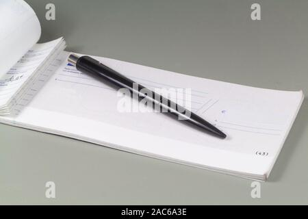 French checkbook to pay in euros and black pen - Stock Photo