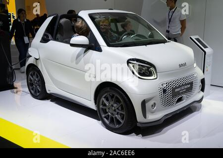FRANKFURT, GERMANY - SEPT  20 2019: yellow SMART EQ FORTWO small electric car from MERCEDES-BENZ, IAA International Motor Show Auto Exhibtion. - Stock Photo