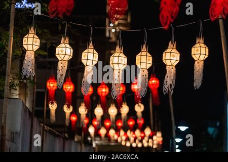 Loy Krathong festival in Chiangmai. Floating hot air balloons made of paper. Festival held yearly at November. - Stock Photo