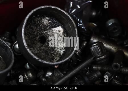 Kuwait City/Kuwait - 12/01/2019: Grimy and soiled steel oil change tools and equipment - Stock Photo