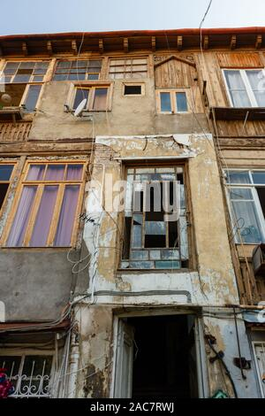 Entrance with facade of old houses in historical part of Tbilisi, Georgia. - Stock Photo