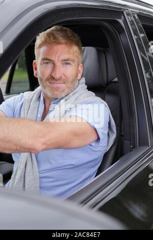 private driver inside car waiting for client - Stock Photo