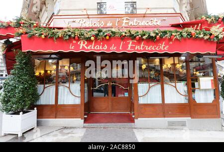 Le Relais de lEntrecote is traditional French restaurant decorated for Christmas. It located in historical centre of Paris near Champs Elysees avenue