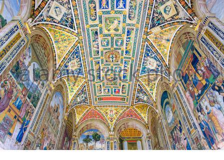 Paintings by Pinturicchio (Bernardino di Betto) on the ceiling of Piccolomini Library at Duomo di Siena (Siena Cathedral). Siena, Tuscany, Italy, Euro - Stock Photo